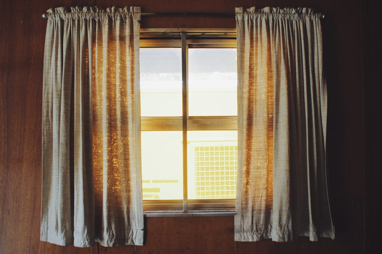 residential-window-with-curtains