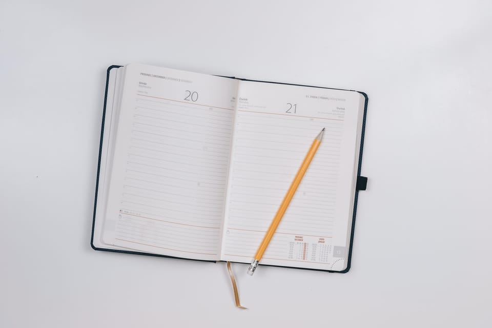 pencil laying on an open notebook