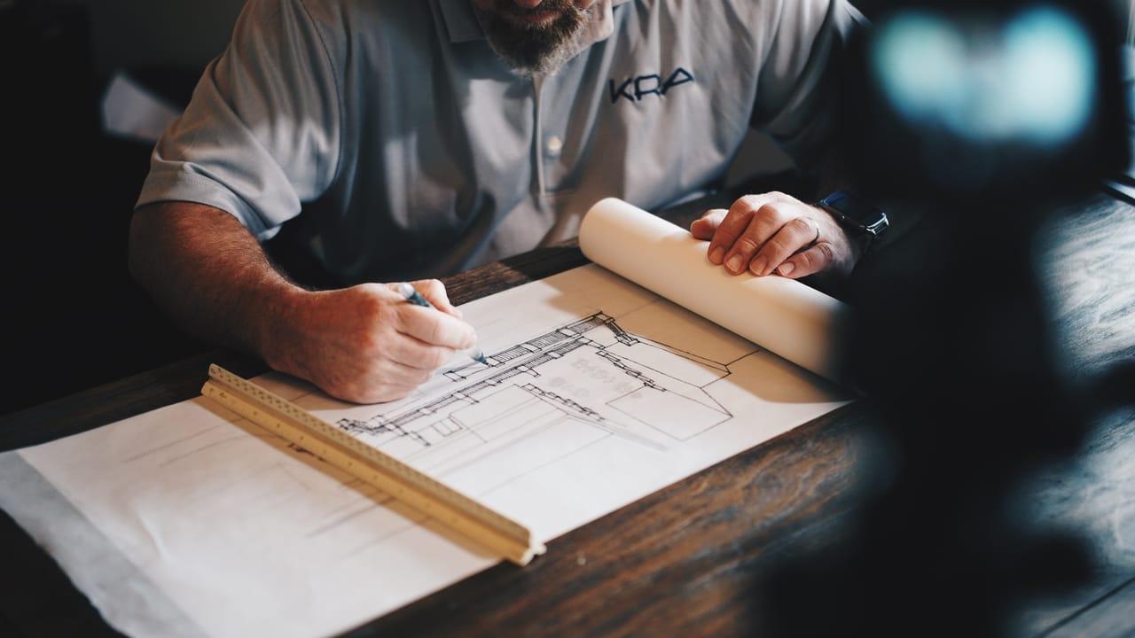 architect-working-on-blueprints