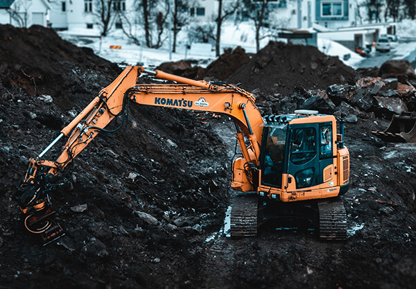 excavator-digging-up-dirt-in-rural-area